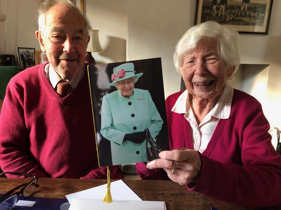 STORIES TO TELL: John and Sue Knights with the card sent by the Queen