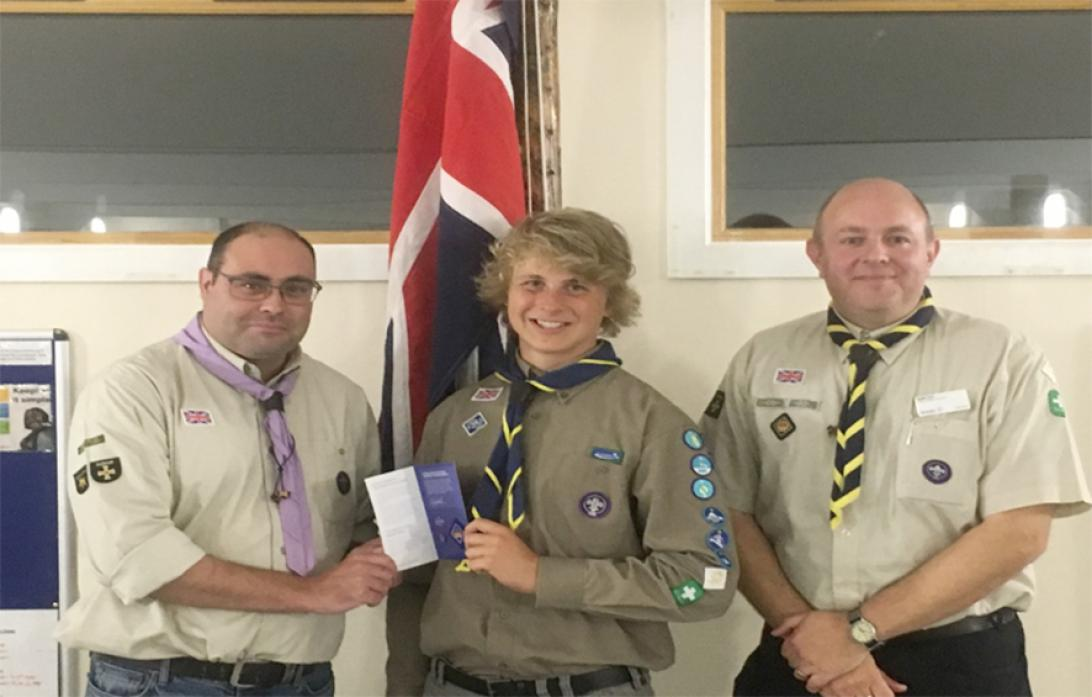ALL SMILES: Sam Arundel receives his Queen's Scout Award from Scott Doughty, left. Also pictured is Andy Carr, District Explorer Scout commissioner