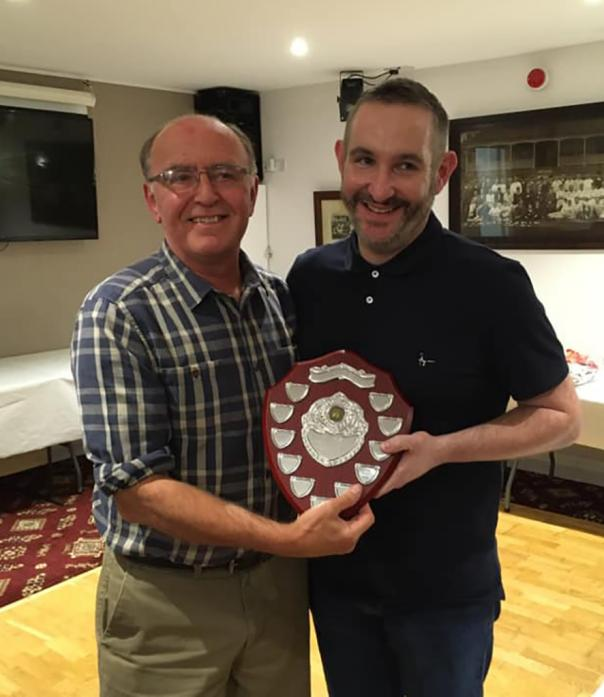 Cliffe chairman Ian Peacock presents Chris Easby with the award for player of the season.