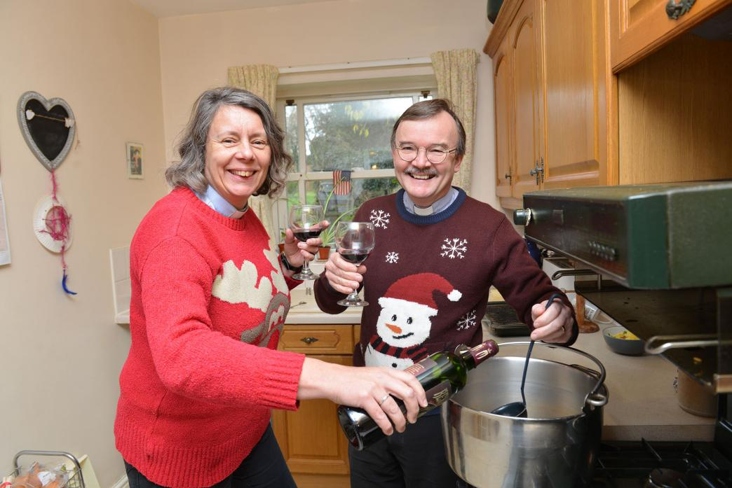 CHRISTMAS CHEER: St Mary's curate Revd Sarah Cliff learns vicar Revd Canon Alec Harding's secret mulled wine recipe ahead of the church's Christmas Tree Festival			         TM pic