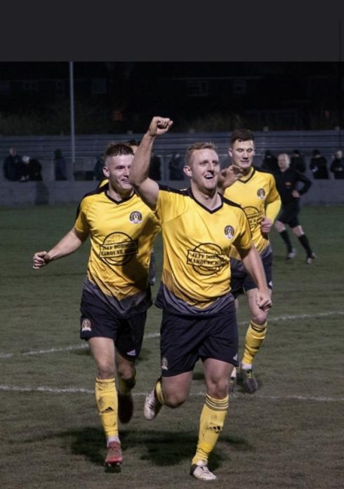 ON TARGET: David Dowson celebrates after scoring one of his two goals                                                                            Photo by Philip Sage