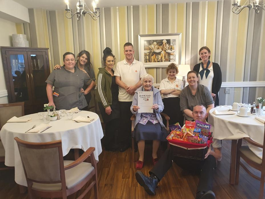 KINDNESS COSTS NOTHING: Linnie Kavanagh presents the Kindness in Caring award to staff at Beaconsfield Court care home, in Barnard Castle