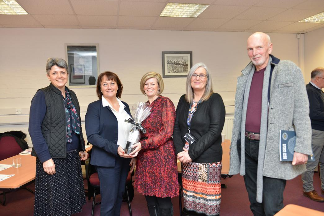 WINE WINNER: Lucky winner Sue Hewison of Handelsbanken receives her prize from Carrie Wilson of Bon Couer Fie Wines while Sue Gilbert, of Teesside University and Emma King and Alistair Dinwiddie of Enterprise House look on here