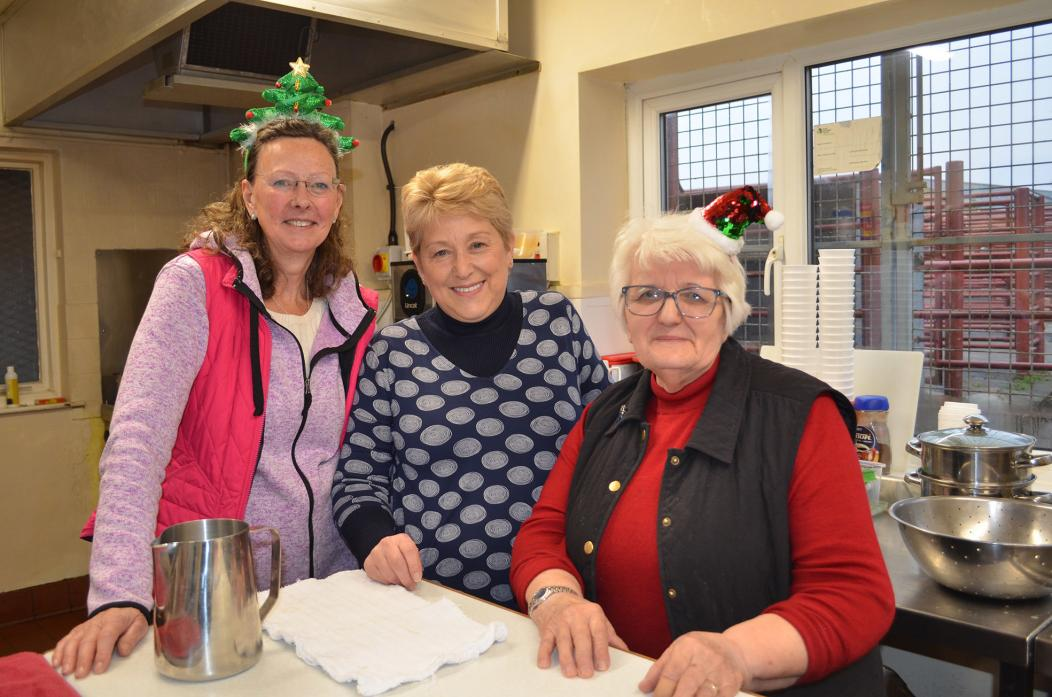 COOKING UP A TREAT: Utass volunteers Lezley Aldrich, Janice Allinson and Rosemary Thompson whipped up a mouthwatering festive meal for retired farmers		            TM pics