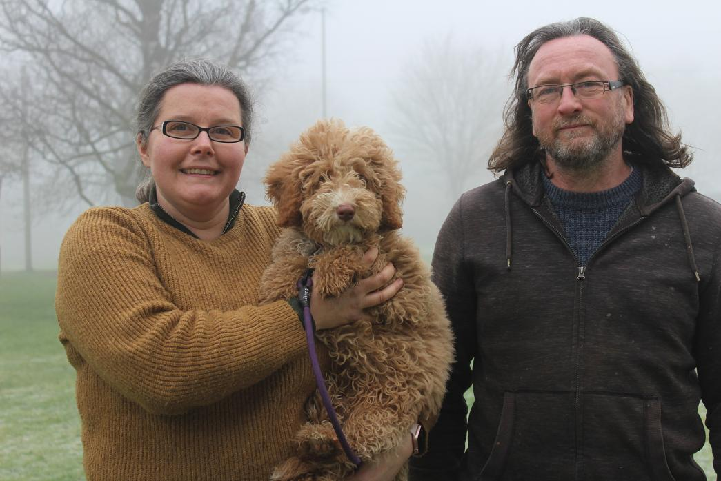 WALKIES: Tracy Lamont, with husband Nik, has swapped teaching for dog walking with the launch of Hound Heroes