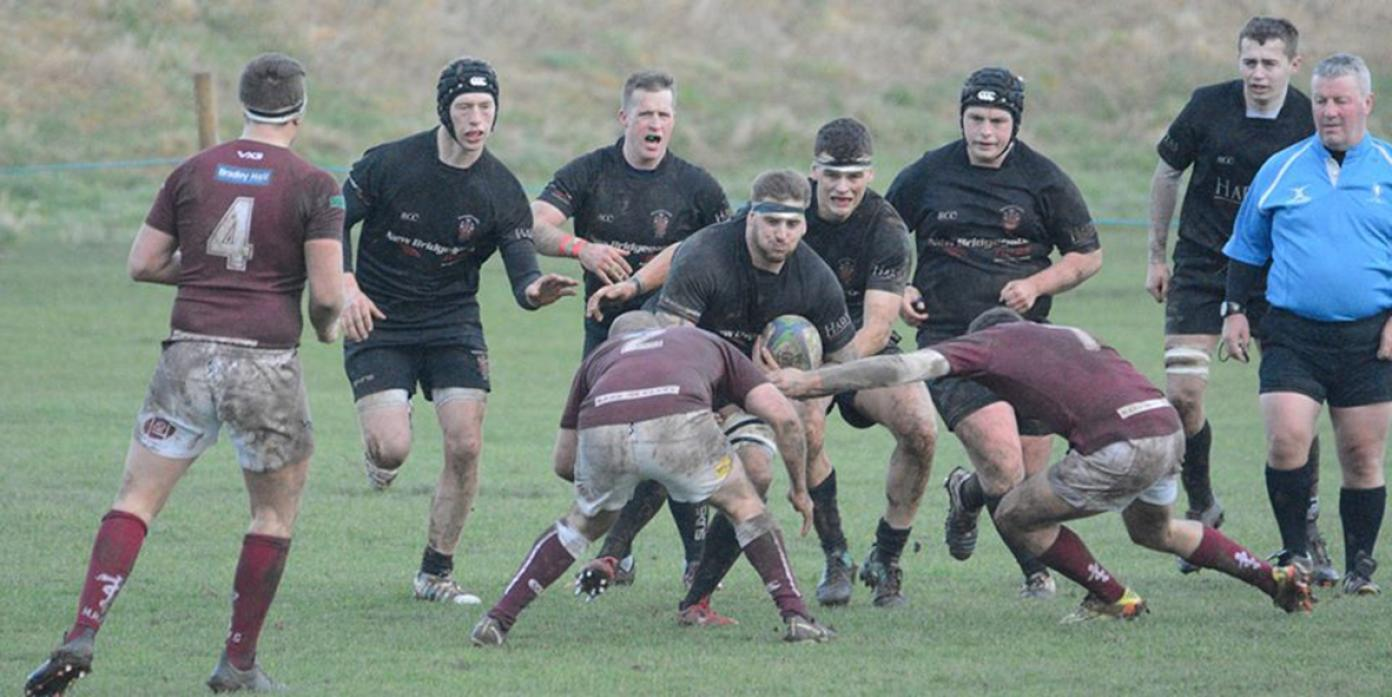 TOUGH GOING: Action from Saturday's game against Medicals, which was played in difficult conditions 	         Pic: Chris Morse