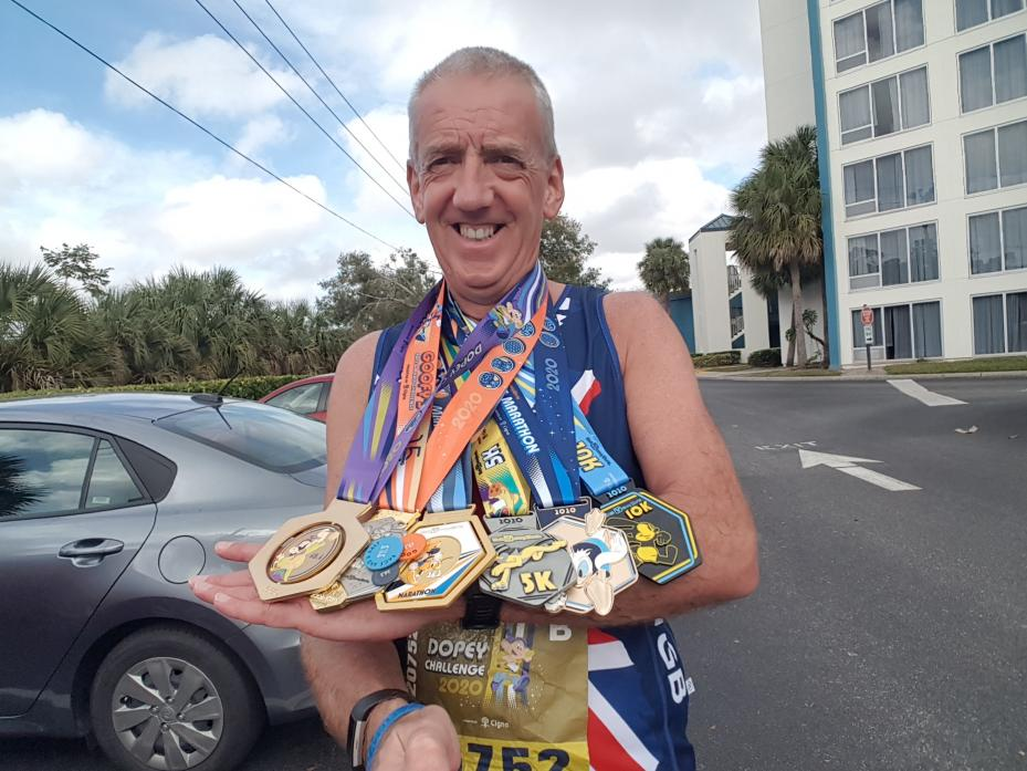 COLOURFUL ARRAY: Andrew Aislabie with the medals he picked up in the Walt Disney Dopey Challenge in the USA