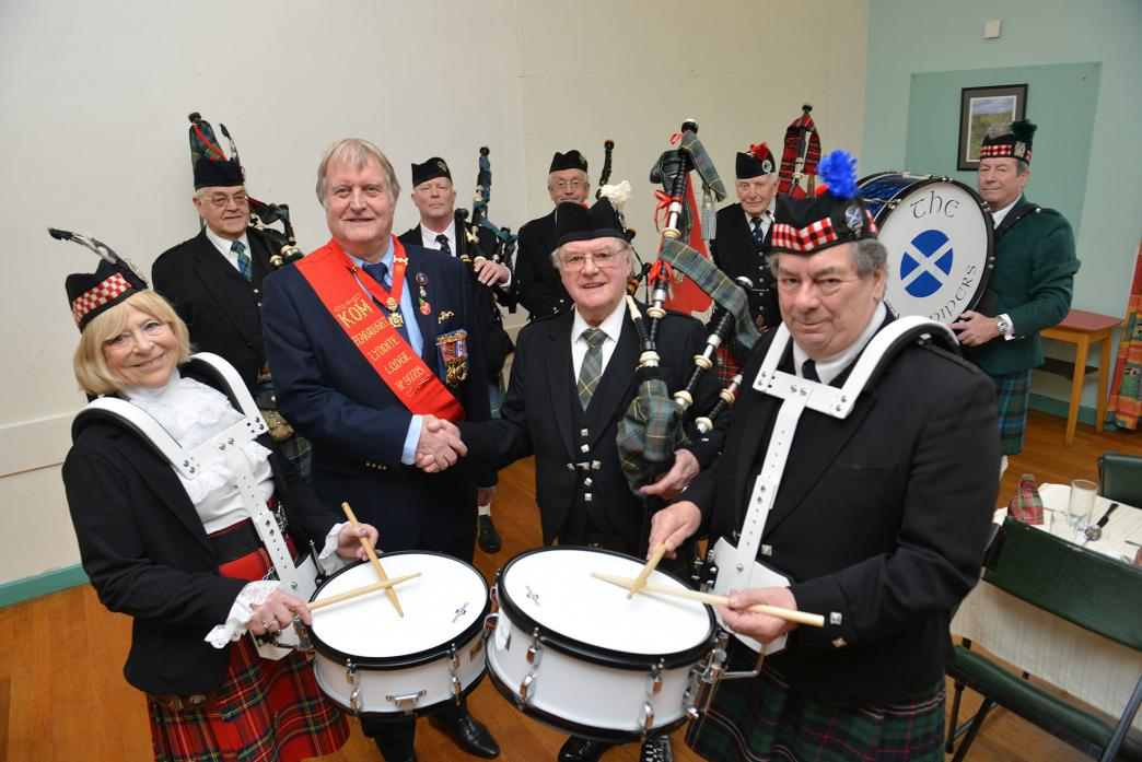 MUSICAL GROUP: The secretary of the King Edward VIII Lodge of the Royal Antediluvian Order of Buffaloes, Roy Fletton, and Vintage Pipes and Drums organiser Barry Waldron are flanked by drummers Catherine Tannasee and Malcolm Bonnett with their new snare d