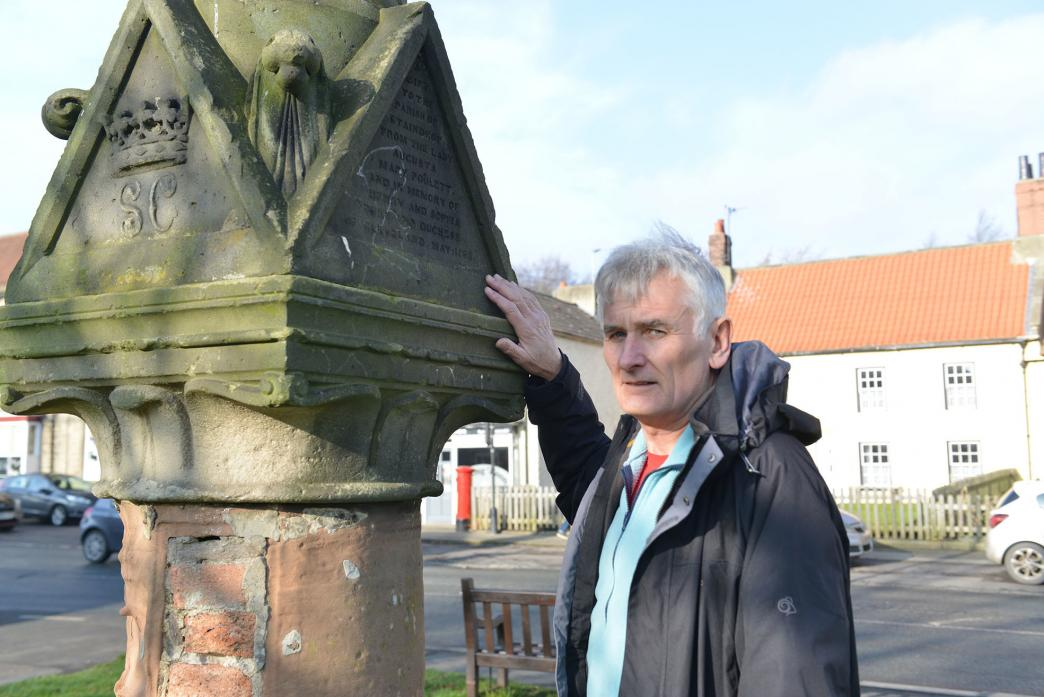 RESTORATION: Staindrop parish councillor Ed Chicken with the water fountain in Staindrop