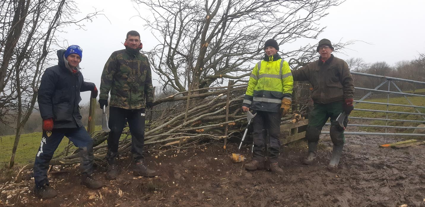 NEW SKILLS: Tutor Bert Hunter with the hedge-laying trainees