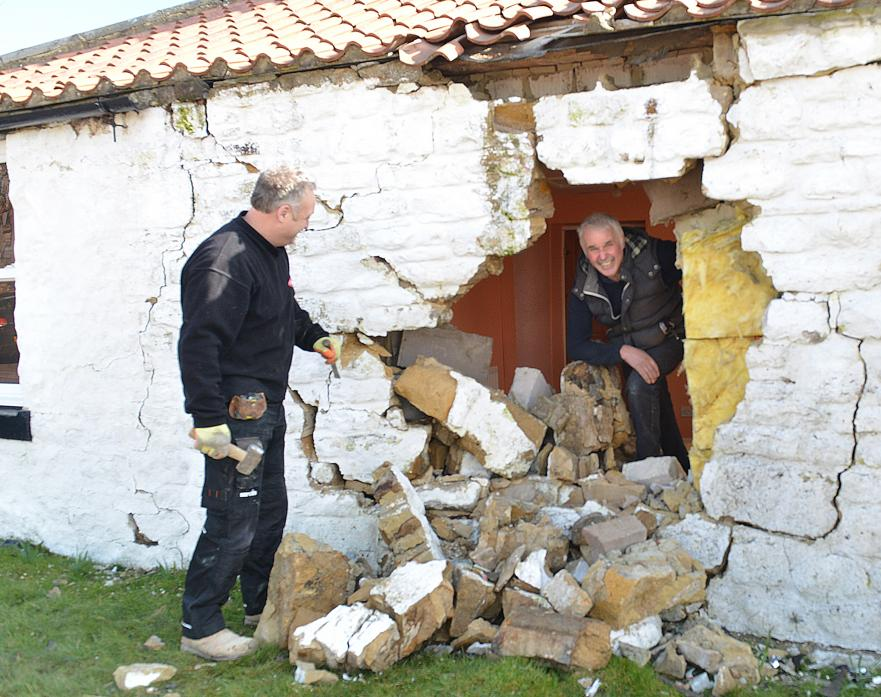 NOT AGAIN: Jim Brough inspects damage caused when a SUV crashed into his home at Kinninvie crossroads while David Walton, of DW Walton Stonemasons, prepares to carry out repairs TM pic