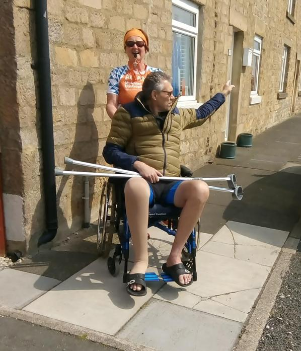 POINTING THE WAY: Amanda Pettitt completed the last 2.6 miles of a relay marathon pushing injured husband Simon in a wheelchair to raise cash for Muscular Dystrophy. Ms Pettitt will line up in the rescheduled London Marathon in October