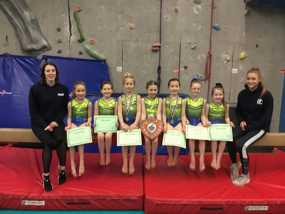 WELL DONE: The Barnard Castle gymnasts, from left, coach Alex Burrell, Sydney Mitchell, Lily Makepeace, Bella Dupuy, Maisie Harris, Isabella Killeen, Delilah Stephenson, Stevie Mitchell and coach Claudia Barkes