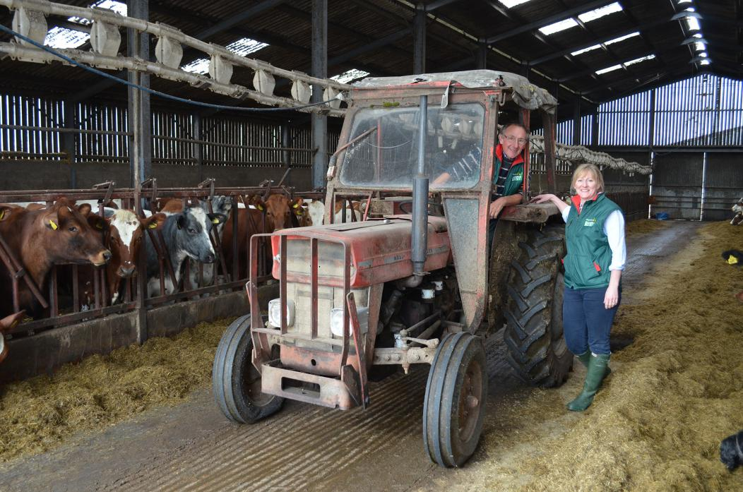 FAMILY BUSINESS: Co-director of Acorn Dairy, Caroline Bell, pictured with her father Gordon Tweddle in a 1968 Massey Ferguson 135 which was used on the farm by her grandfather John Tweddle