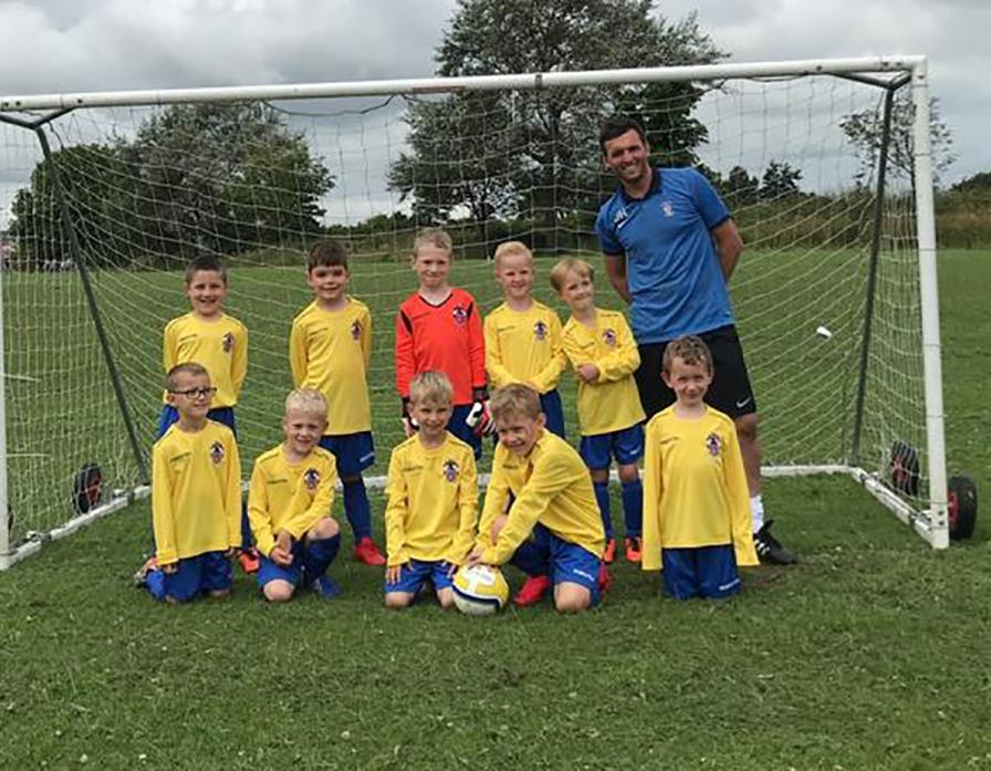 WELL PLAYED: The Barnard Castle U7 team with manager Darren Harrison