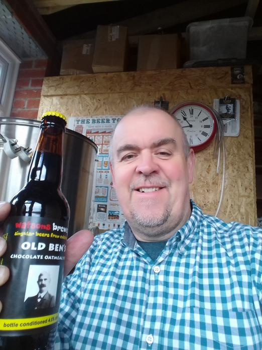 DARK BREW: Brewer Mark Watson with the stout he created to honour his great-grandfather