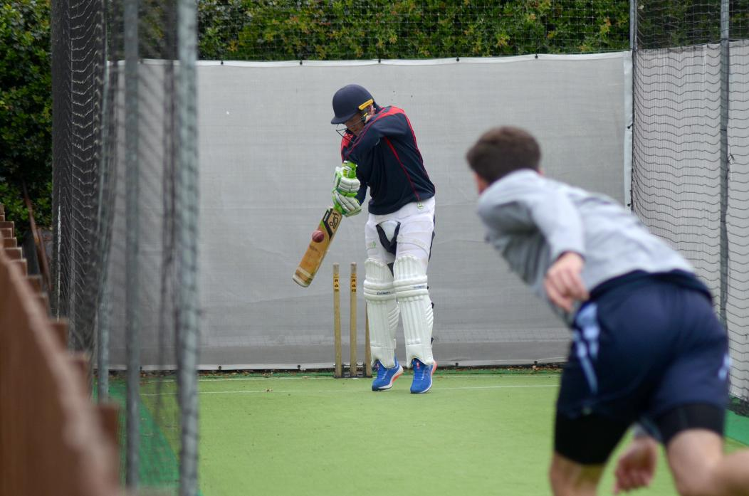 Phil Merryweather fends a delivery away in the artificial net.