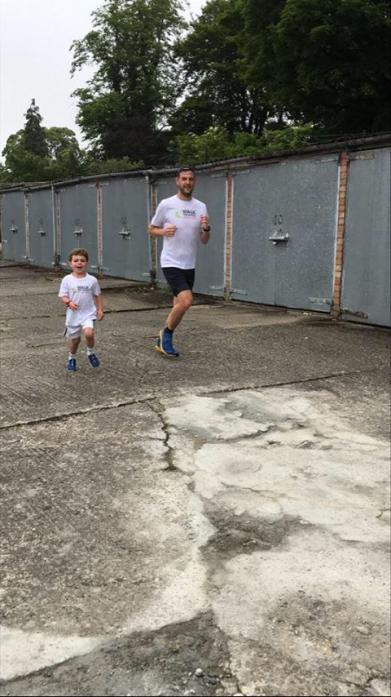KEEP ON RUNNING: Kevin Maughan runs around his cul-de-sac on his way to a marathon