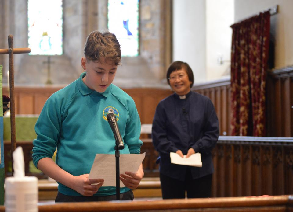 FAREWELL: Gainford pupil Alex at the leavers' service in St Mary's church. He is pictured with Revd Eileen Harrop.