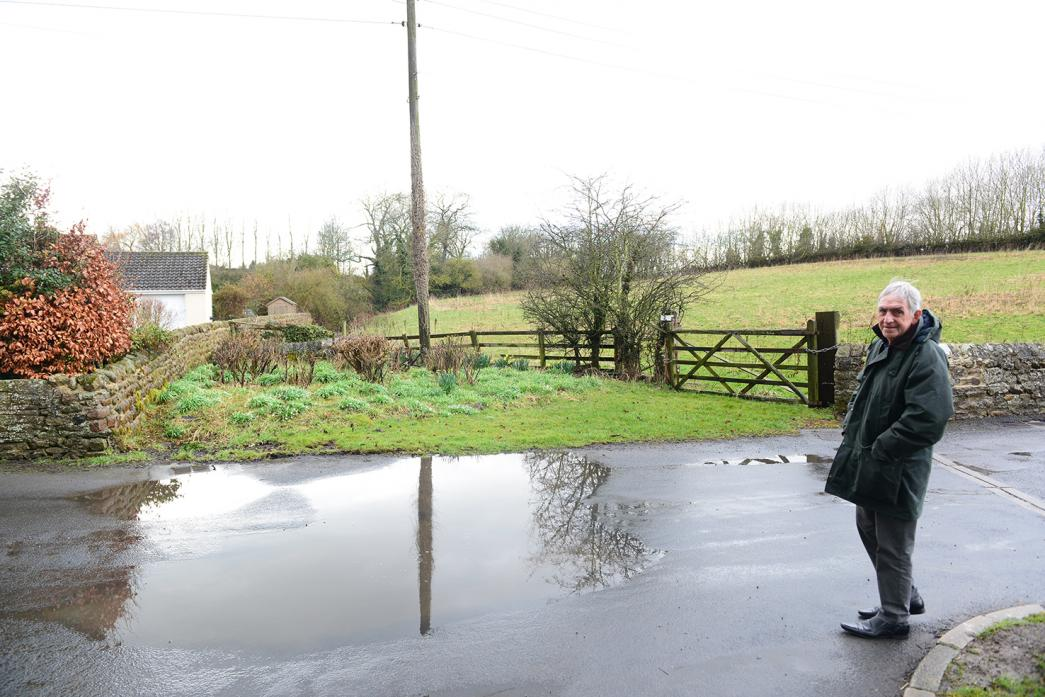 FLOODING FEARS: Winston Parish Council chairman Cllr Mike Taylor at the entrance to the site where a developer proposes to build 16 new homes