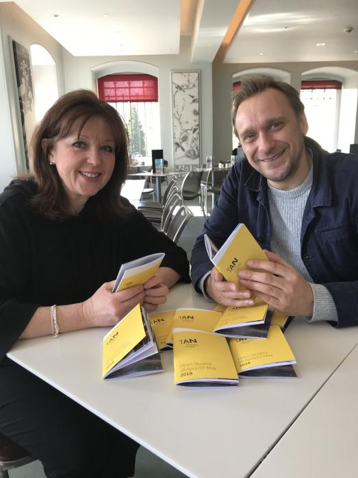 SHOWCASE EVENT: Artist Jane Young receives the open studios brochures from designer Ryan Plews