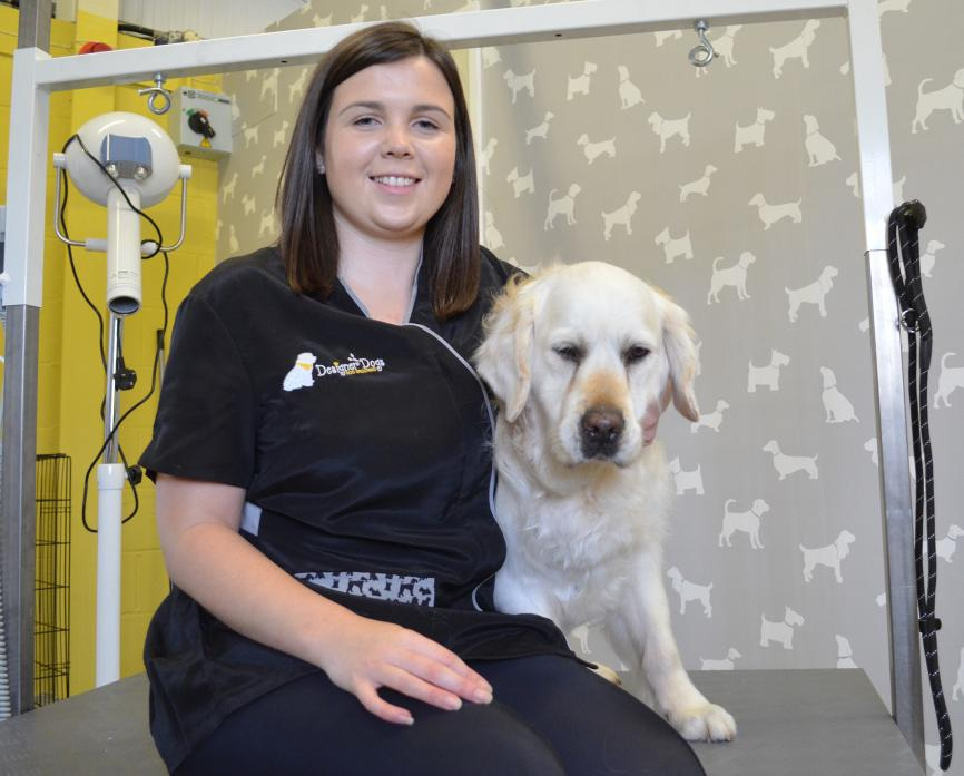 NEW VENTURE: Charlotte Buck, pictured with her golden retriever Gemma, has combined her love of animals with an ambition to run her own business to launch Designer Dogs