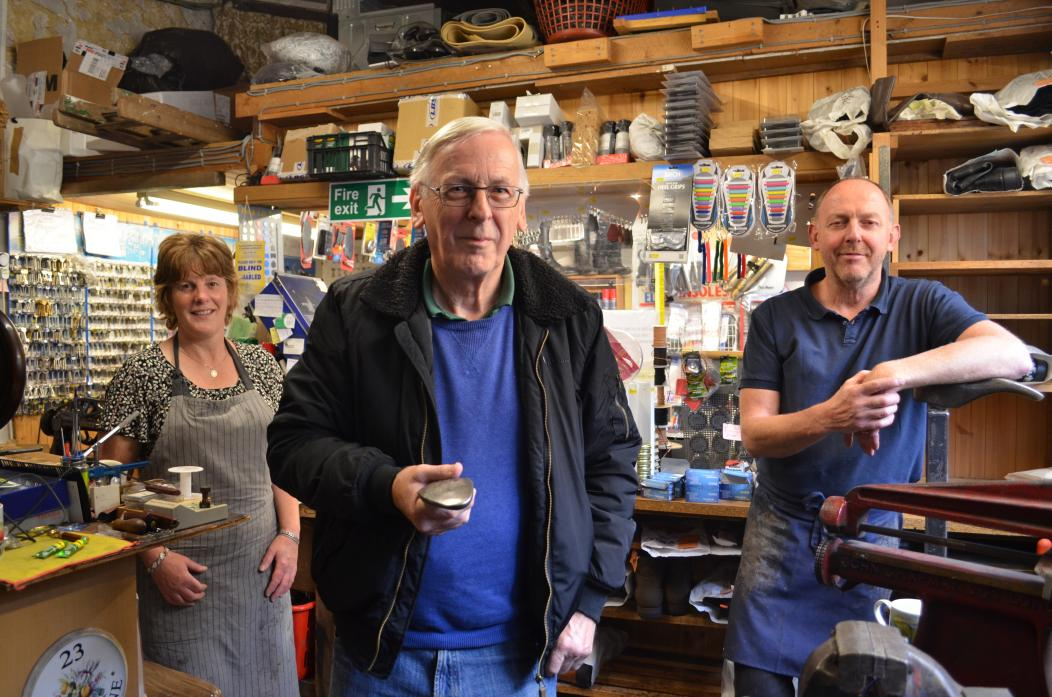 END OF AN ERA: David Haywood, centre, with apprentice cobbler Angela Harland and Adrian Andrews