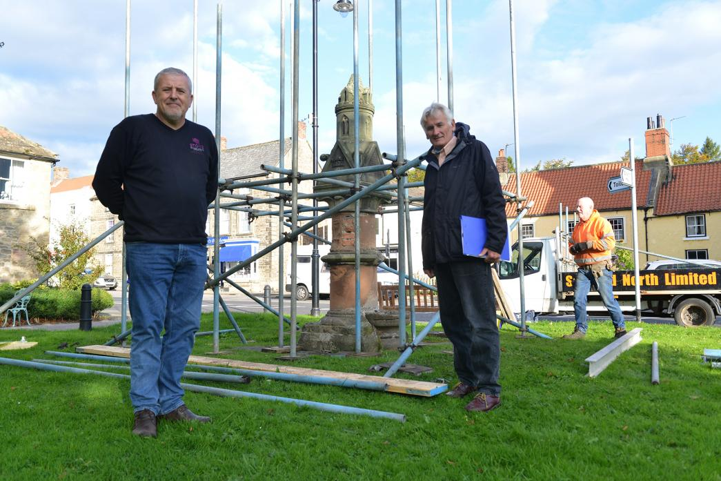 VITAL WORK: Stonemason Graham Stone and parish councillor Ed Chicken with the Victorian drinking fountain that is being dismantled ahead of being restored