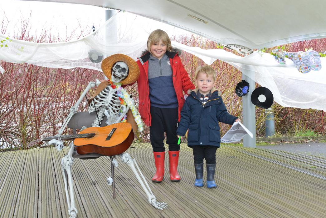 SPOOKY FUN: Left, Joey Dominick and Harry Davison enjoyed the guitar playing skeleton. Below, Art, Kit and Flossie Collyer prepare to set off on The Hub's Halloween trail