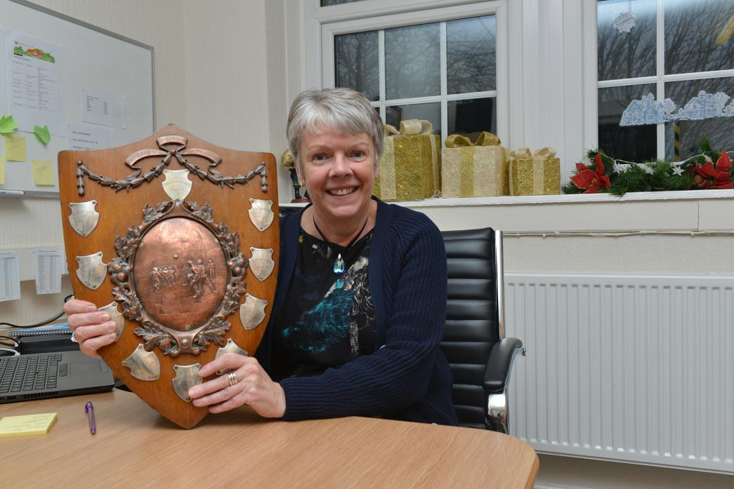 IT'S A MYSTERY: Cockfield Primary School headteacher Kathryn Heatherington a with the rediscovered football trophy from 1901