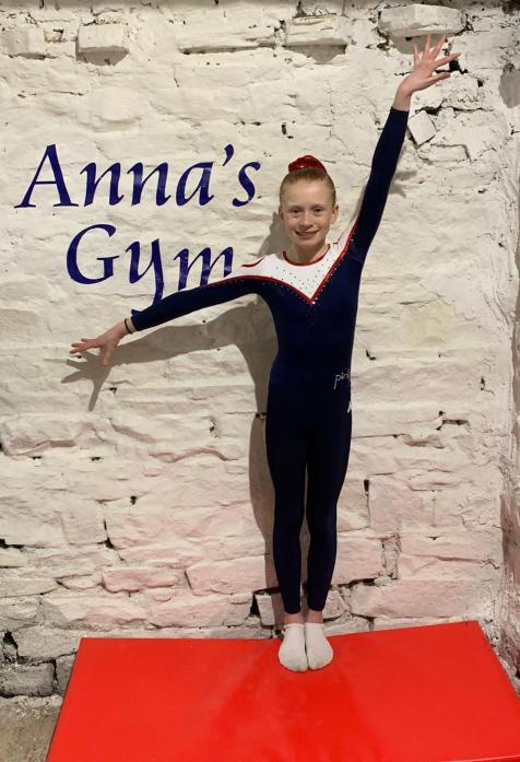 YOUNG FUNDRAISER: Gymnast Amy Metcalf has raised £1,000 for charity
