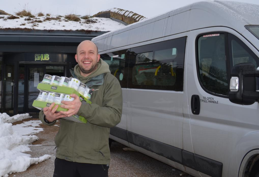 CARRY ON CARING: Jonny Elliott, facilities manager at the TCR Hub, with some of the donated food