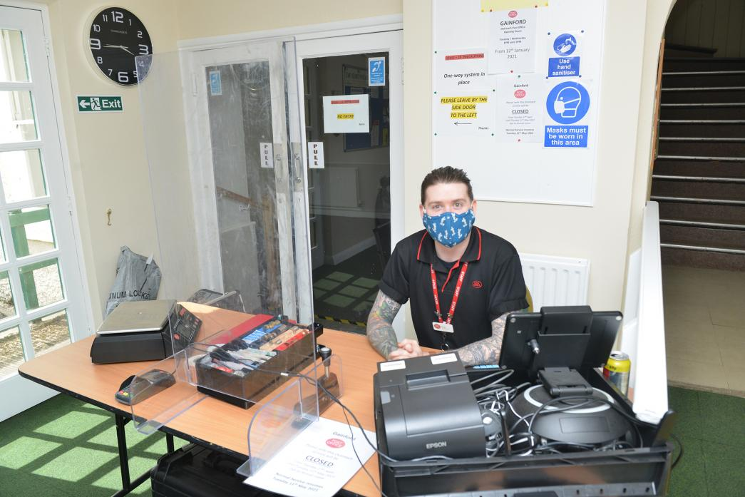 BUSY SERVICE: Kieran Elliot manages the outreach Post Office at Gainford Village Hall