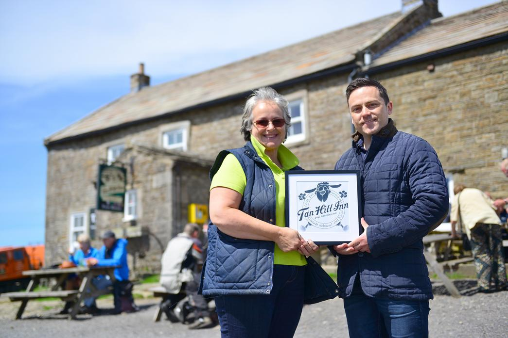 NEW OWNER: Andrew Heild symbolically receives a Tan Hill Inn logo from former landlady Louise Peace to mark the pub coming under new ownership