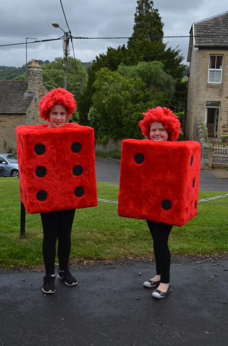 NUMBERS GAME: Friends Tiggy Johnson and Lydia Swinburn dressed as dice during the parade