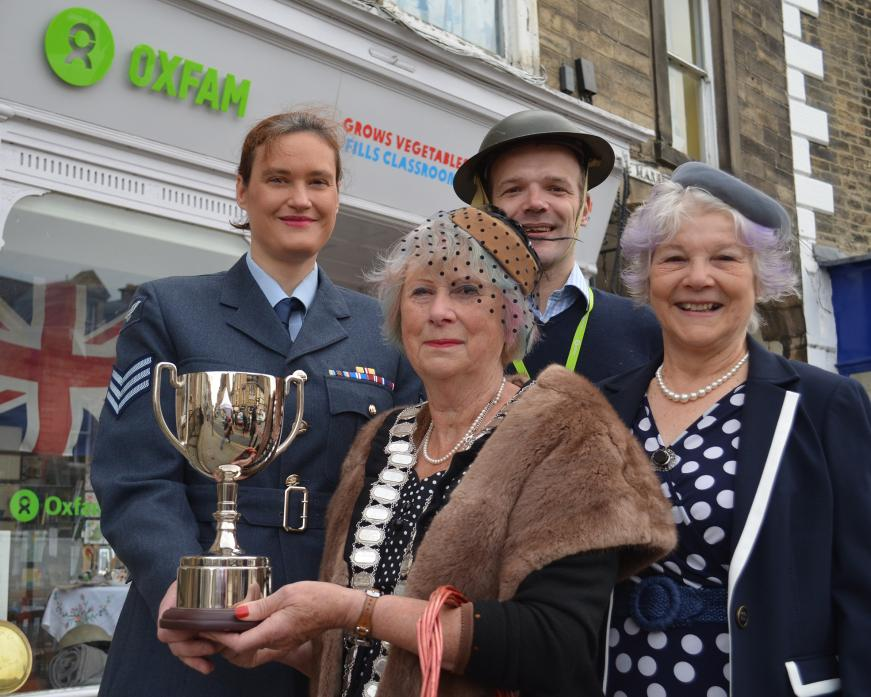 GOOD SHOW: Oxfam shop manager Caroline Cellier, left receives the trophy for the best 1940s shop window display from mayor Cllr Sandra Moorhouse, with volunteers Will Wearmouth and Jan Fowler