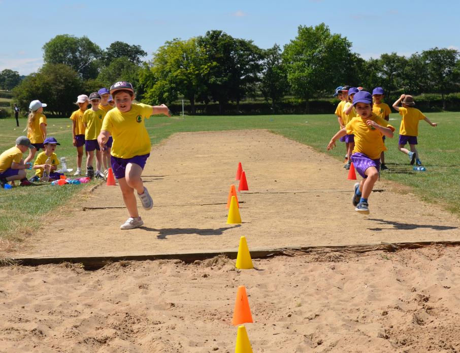 JUMP TO IT: Ingleton pupils try out the long jump