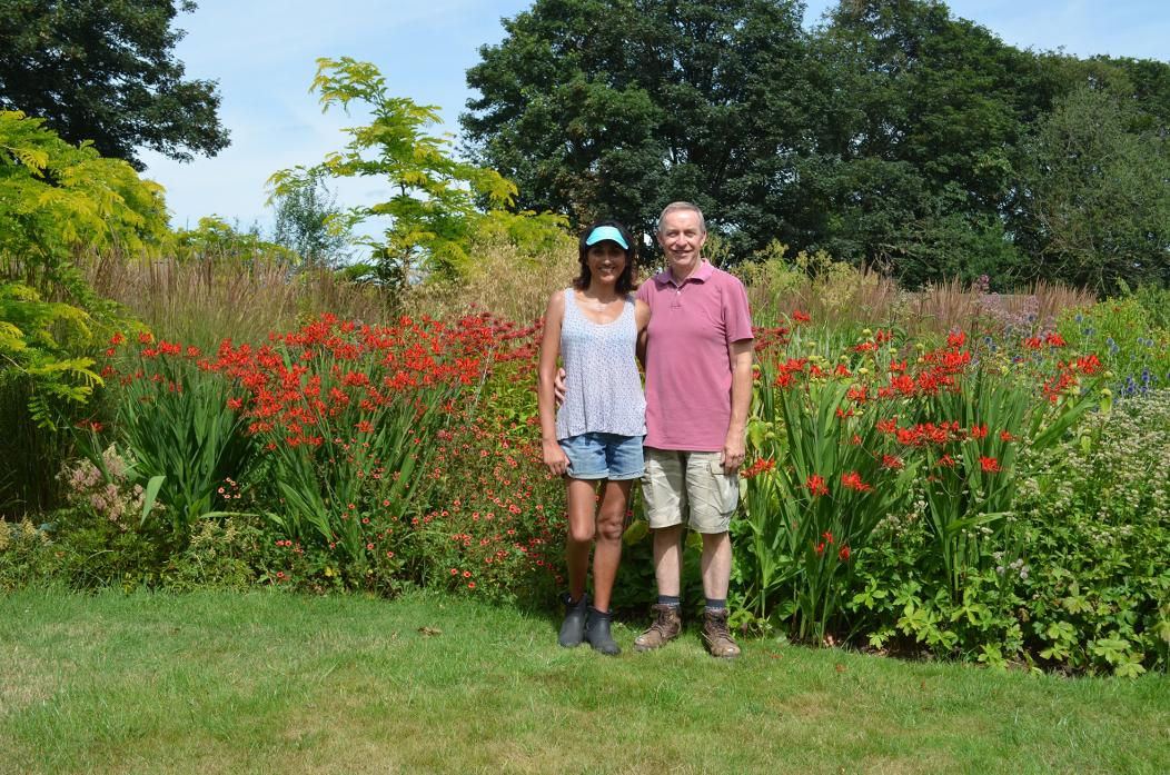BLOOMING: Dr Satinder Sanghera and her husband, Mike, are in their garden at Woodside in Killerby