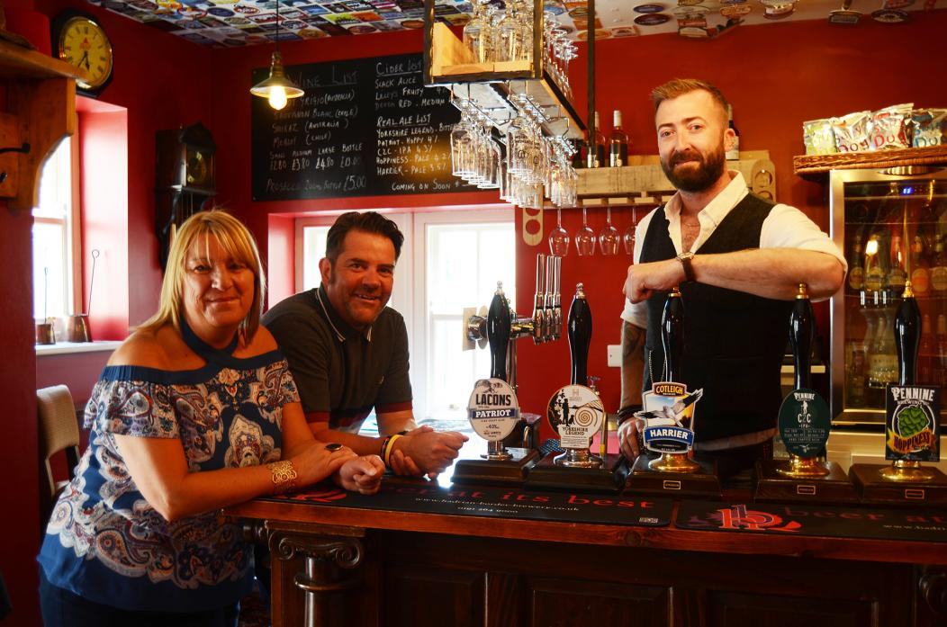 CHEERS: Handing over the keys to the Firkin Alley, Ryan and Ali Stones congratulate new owner Jamie Kidd