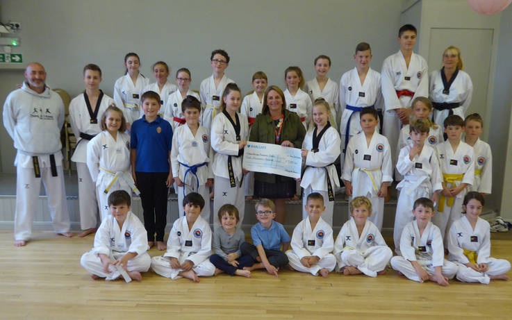 Martial arts group donates £500 to founder of heart-start charity