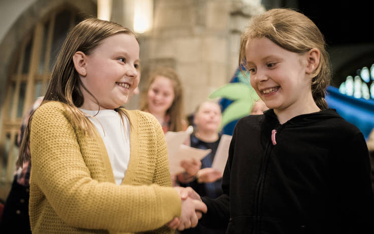 Primary pupils tell a biblical story of friendship and loyalty